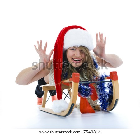 Beautiful  young woman on sledge on isolated background
