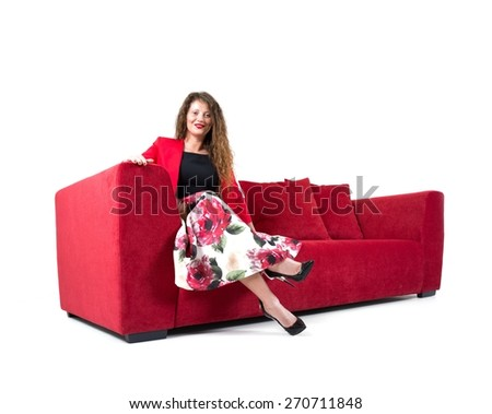 Beautiful young woman on sofa isolated - stock photo