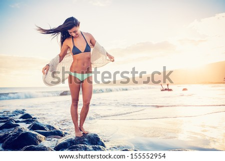 Beautiful Young Woman on the Beach at Sunset, Dreamy Lighting - stock photo