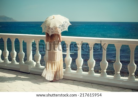 Beautiful young woman on the beach. Ocean. Fashion photo - stock photo