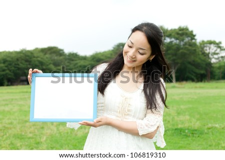 Beautiful young woman on the green. Portrait of asian.