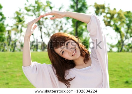 Beautiful young woman on the green. Portrait of asian woman. - stock photo