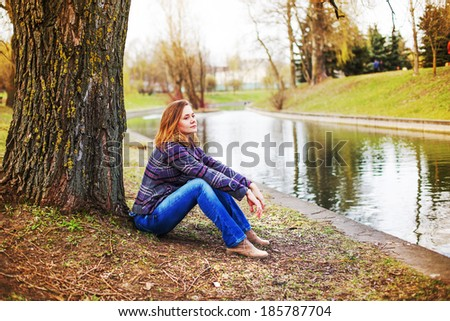 beautiful young woman on the nature background