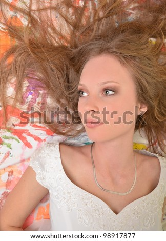 Beautiful young woman on white background with colored fingerprints