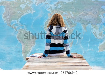 Beautiful young woman on world map background. Travel concept - stock photo