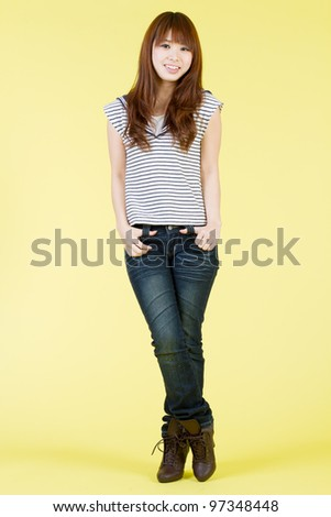 Beautiful young woman on yellow background. Portrait of asian woman. - stock photo