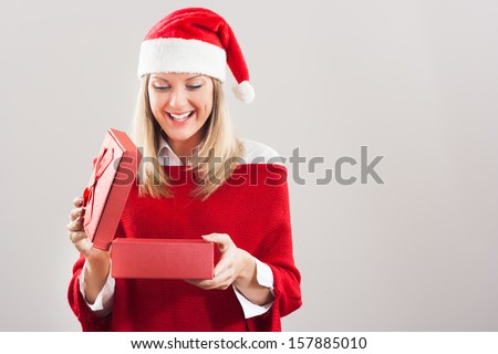 Beautiful young woman opening Christmas present,Christmas gift - stock photo