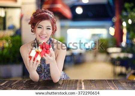 Beautiful young woman opening gift box,  - stock photo