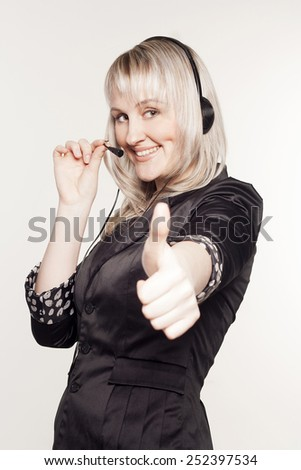 Beautiful young woman operator with head-set - stock photo