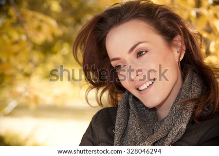 Beautiful young woman out for a walk on a fresh sunny autumn day