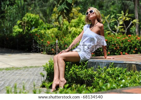 Beautiful young woman outdoors - stock photo