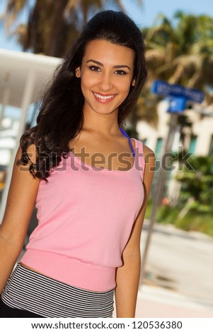 Beautiful young woman outdoors enjoying Miami Beach. - stock photo