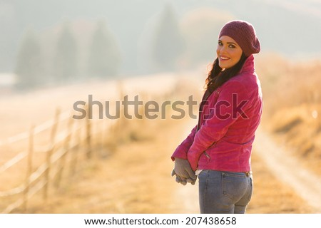 beautiful young woman outdoors in the cold autumn morning - stock photo