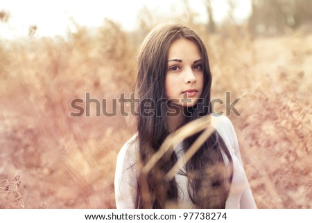 beautiful young woman outdoors in the spring - stock photo
