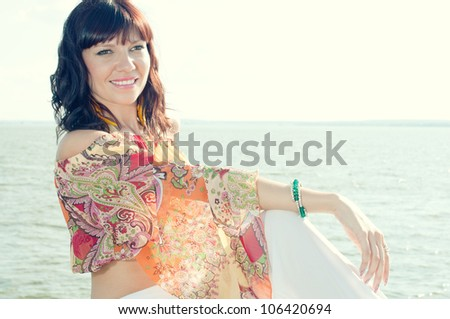 Beautiful young woman outdoors, looking rested and relaxed - stock photo