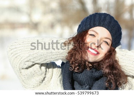 Beautiful young woman outdoors on winter day