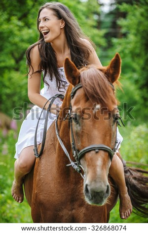 beautiful young woman park riding horse