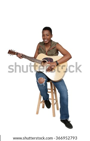 Beautiful young woman playing an acoustic guitar