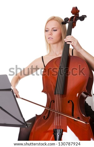 Beautiful young woman playing cello. Isolated on white