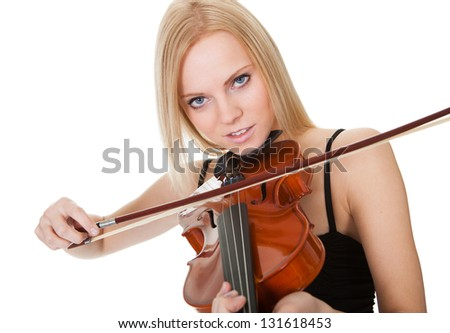 Beautiful young woman playing violin. Isolated on white