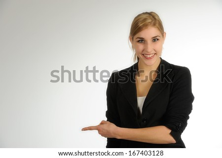Beautiful young woman pointing her finger - stock photo