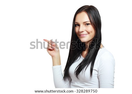 Beautiful young woman pointing to somewhere - stock photo