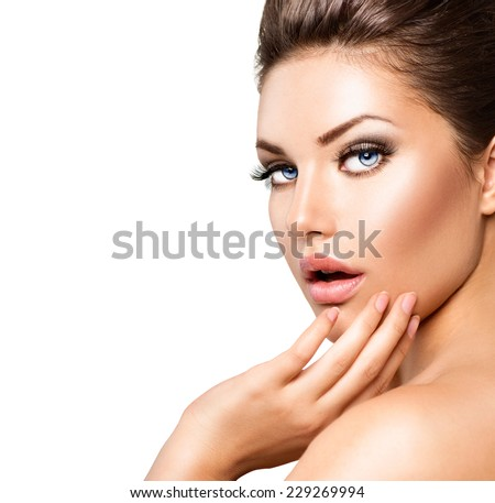 Beautiful young woman portrait. Beauty girl face. Perfect skin, skincare. Gorgeous lady with Clean Fresh Skin close up isolated on white. Spa Woman touching her skin - stock photo