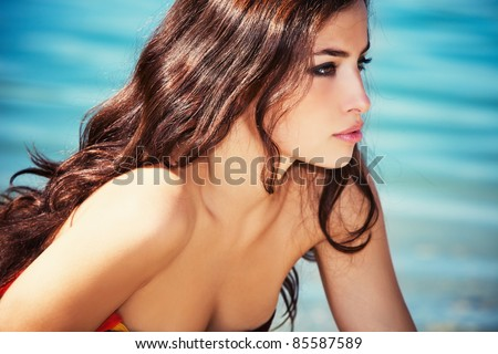 beautiful young woman portrait by the sea, profile,