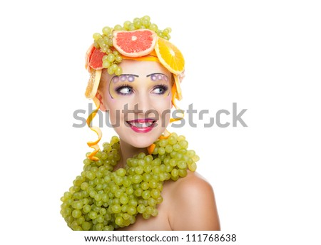 beautiful young woman portrait excited smile with fantasy art hair makeup style, fashion girl creative food fruit orange, grapes, citrus make up looking side empty copy space isolated white background - stock photo