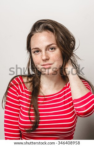 Beautiful young woman portrait freckles smiling posing attractive brunette  - stock photo