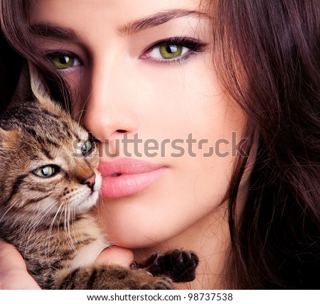 beautiful young woman portrait holding kitten, close up - stock photo
