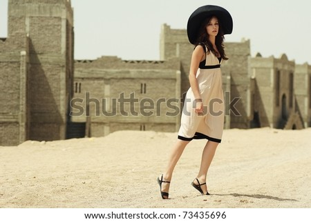 beautiful young woman portrait in a desert - stock photo