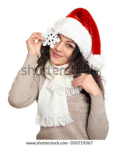 beautiful young woman portrait  in santa helper hat with big snowflake posing on white