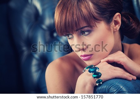 beautiful young woman portrait. jewerly and diamonds