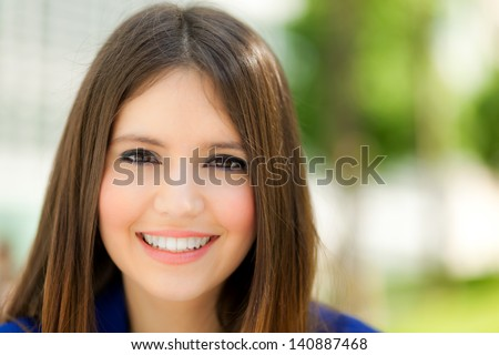 Beautiful young woman portrait outdoor - stock photo
