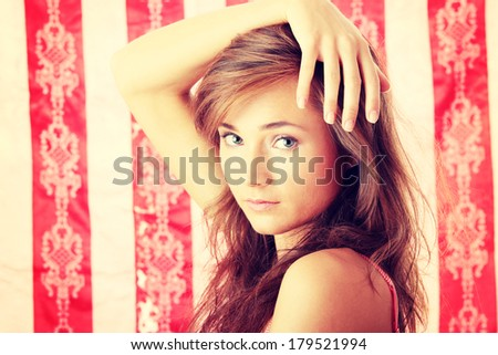 Beautiful young woman portrait over pink background - stock photo