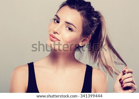 Beautiful young woman portrait smiling posing attractive blond  - stock photo