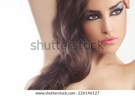 beautiful young woman portrait with black eyeliner makeup, studio white