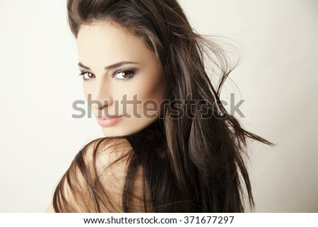 beautiful young woman portrait with brown hair and eyes, studio white
