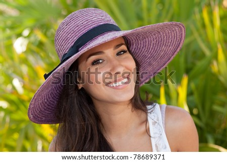 Beautiful young woman posing along the South Beach promenade in Miami Beach. - stock photo