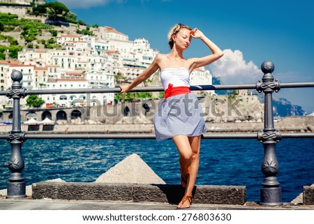 Beautiful young woman posing in Atrani town in Amalfi coast. Italy