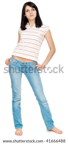 Beautiful young woman posing in jeans and t-shirt - stock photo