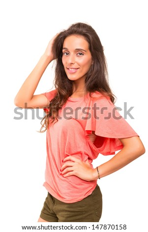 Beautiful young woman posing isolated over white background