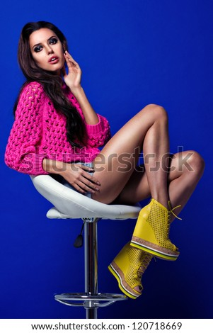 Beautiful young woman posing on the chair