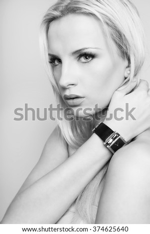 beautiful young woman posing wearing casual clothing and posing with wrist watch