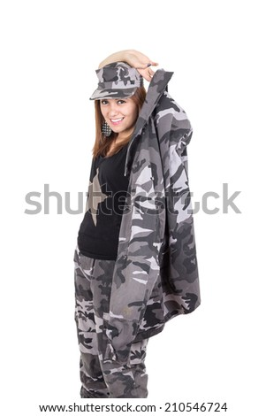 Beautiful young woman posing with gray military uniform putting jacket on isolated on white