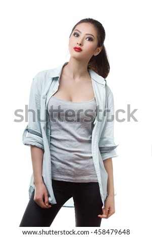 Beautiful young woman posing with serious fashion look in casual. Mixed race Asian Chinese White Caucasian female model. - stock photo