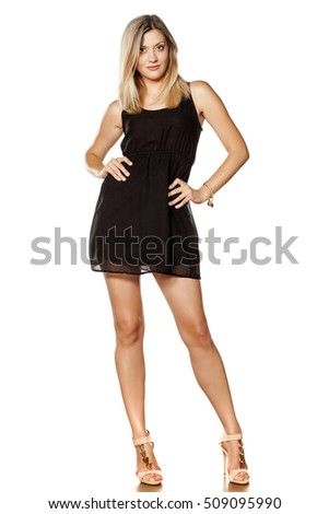 beautiful young woman posing with short black dress
