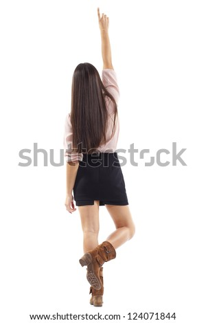 beautiful young woman raises her arm back - stock photo