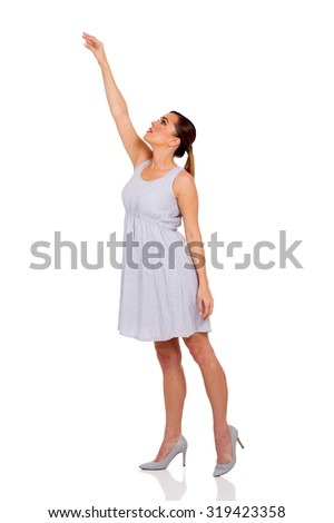 beautiful young woman reach out on white background - stock photo